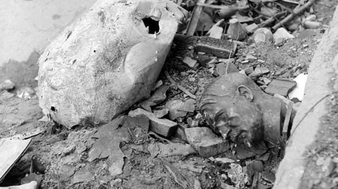 Not published in LIFE. An image almost too perfectly symbolic of Berlin in 1945: A crushed globe and a bust of Hitler amid rubble outside the ruined Reich Chancellery.